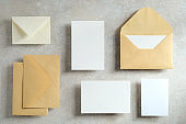Wedding cards mockup and envelopes on stone table. Top view, flat lay.