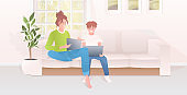 mother with son using laptops happy family spending time together modern living room interior