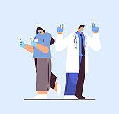 doctors in protective masks holding syringe and bottle vial coronavirus vaccine development fight against covid-19