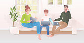 parents with child using laptops happy family spending time together modern living room interior