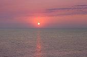 Amazing beach sunset with endless horizon. Horizontal. Selective focus.