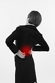 woman suffering from back pain, injury, office syndrome