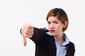 frustrated, unhappy, sad, angry businesswoman or business executive giving thumb down