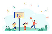 Happy children playing basketball outside together