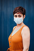 caucasian woman outdoors wearing face mask. Pandemic during corona virus social distance concept.