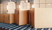 Shipment boxes, packaging, Cardboard boxes sorting on rollers conveyor belt. Manufacturing and factory warehouse. Logistics cargo export.