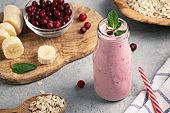 Homemade yogurt smoothie with banana, cranberry and oatmeal