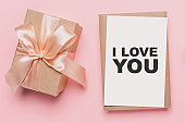 Gifts with note letter on isolated pink background, love and valentine concept with text I love you
