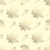 Gold flowers pattern. Seamless pattern with golden chestnut leaves on a beige background. Vector graphics.