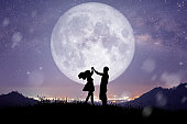 Silhouette of Couple, Lover, Relationship at night landscape.