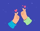 Two human hands showing korean love heart sign by fingers