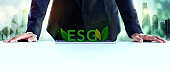 ESG, Ecology Care Concept. Environmental, Social and Corporate Governance. Businessman Planing an ESG Project on Tablet.