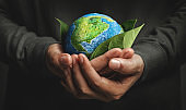 World Earth Day Concept. Green Energy, Renewable and Sustainable Resources. Environmental and Ecology Care