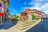 street restaurants and Court of Appeal building in Largo do Misericordia square in Guimaraes city historical centre