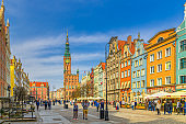 Gdansk cityscape with people tourists walking down Dluga Long Market pedestrian street Dlugi targ square, City Hall