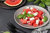 Summer salad of watermelon, feta cheese and green basil, healthy food, Close-up. Horizontal format