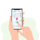 Female hand holding smartphone with city map on screen.