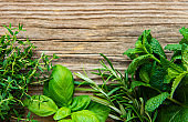 Fresh herbs  on wooden background top view