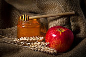 Glass jar of fragrant honey, organic products on a wooden background, burlap. Still life