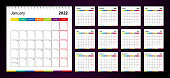 Colorful wall calendar for 2022 on dark background, week starts on Monday.