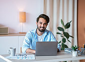Remote Career. Happy Arab Male Entrepreneur Sitting At Desk With Laptop