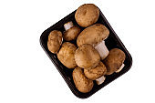 Brown whole mushrooms isolated on white background.