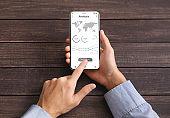 Black businessman using financial app on mobile phone