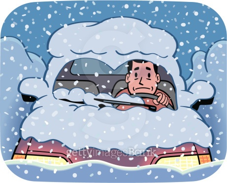 A young adult Caucasian man sitting in his car in the middle of a blizzard