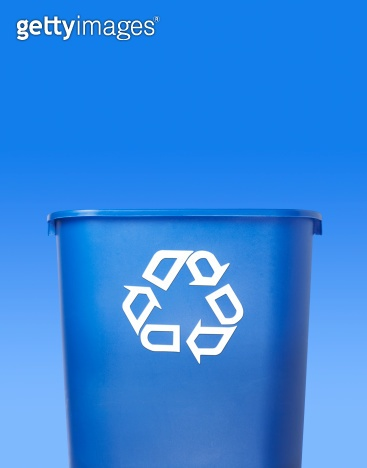 Recycling container against a blue background