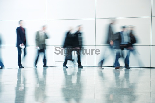 Business Commuters Walking Along Corridor, Blurred Motion