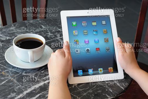 Holding iPad 3