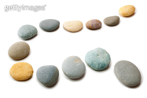 Snaking Line of Twelve Pebbles Steps Isolated