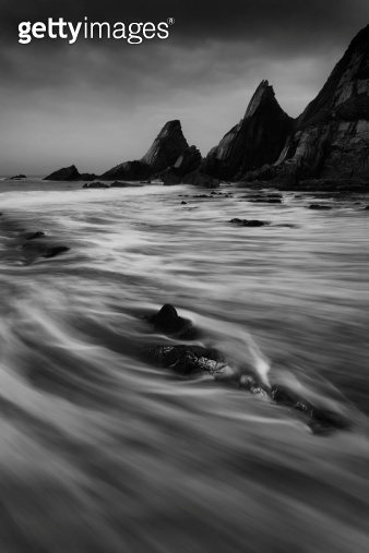 Landscape seascape of jagged and rugged rocks on coastline