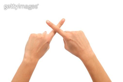 Woman hands crossing fingers
