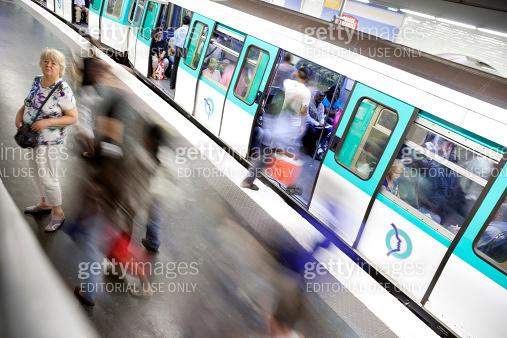 People and Train at Gare de l'Est Metro Station, Paris