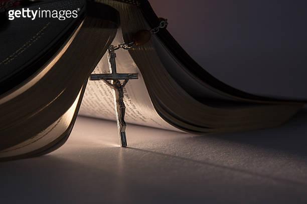 Crucifix propping open the bible
