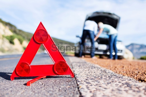 Emergency Sign Along Roadside With Couple Looking Under Car Hood