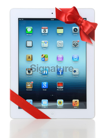iPad 3 with red ribbon
