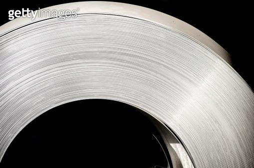 sheet tin metal rol on black background