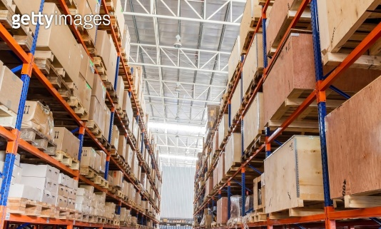Shelves with boxes in factory warehouse