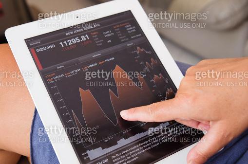 Women Stock analytics check graph on Bloomberg Ipad app