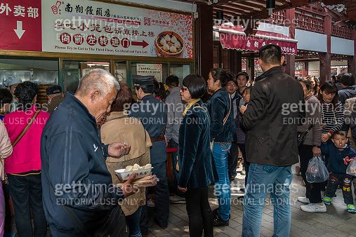 people eating dim sum Shanghai style steamed pork dumplings chin