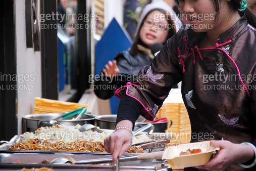 Woman Serving Chinese Food