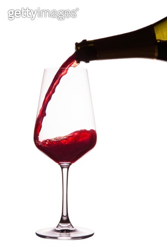 Pouring a glass of red wine. with Clipping path