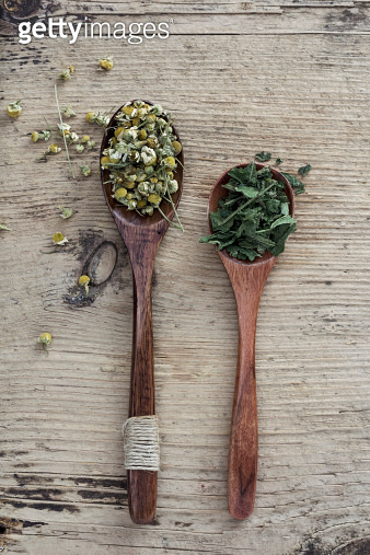 Chamomile and Nettle Tea on wooden background