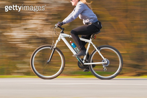 Atractive Blonde Cycling - Blurred Motion