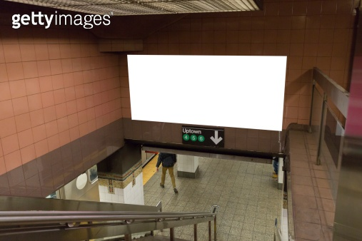 White blank billboards in the subway tunnel.