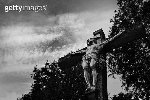 Statue: the crucifixion of Jesus, low key