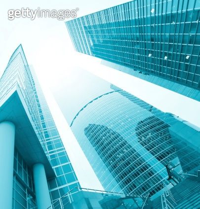 low angle view to blue contemporary glass skyscraprs