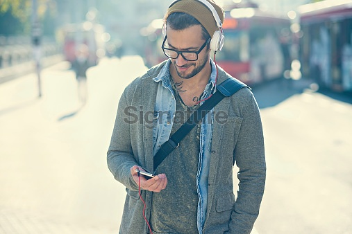 handsome man typing text message